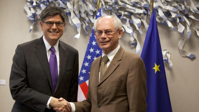 U.S. Treasury Secretary Jacob Lew, left, shakes hands with European Council President Herman Van Rompuy at EU headquarters in Brussels on Monday, April 8, 2013. U.S. Treasury Secretary Jacob Lew is starting a series of meetings with key European Union leaders during his first official visit to the region. Lew is expected to urge the European officials to promote more growth-friendly policies to counter the debt crisis that has for three years engulfed the 27-nation bloc, which together forms the world's largest economy. (AP Photo/Virginia Mayo, Pool)