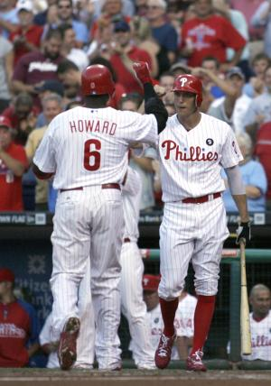Philadelphia Phillies'  Ryan Howard (6) celebrates with Hunter Pence after Howard hit a solo home run against the Pittsburgh Pirates in the second inning of a baseball game, Saturday, July 30, 2011, in Philadelphia.  (AP Photo/H. Rumph Jr)