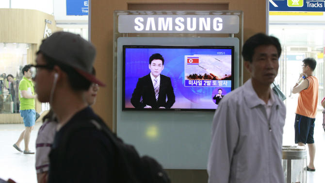 "A TV news program reports on missiles launched by North Korea at Seoul Railway Station in Seoul, South Korea, Sunday, July 13, 2014. North Korea launched ballistic missiles into the sea on Sunday, South Korea said, the latest in a series of test-firings seen as expressions of anger over the North's failure to win talks on receiving outside aid, and over ongoing U.S.-South Korean military drills. The writing on the screen reads "" Launched two missiles."" (AP Photo/Ahn Young-oon)"
