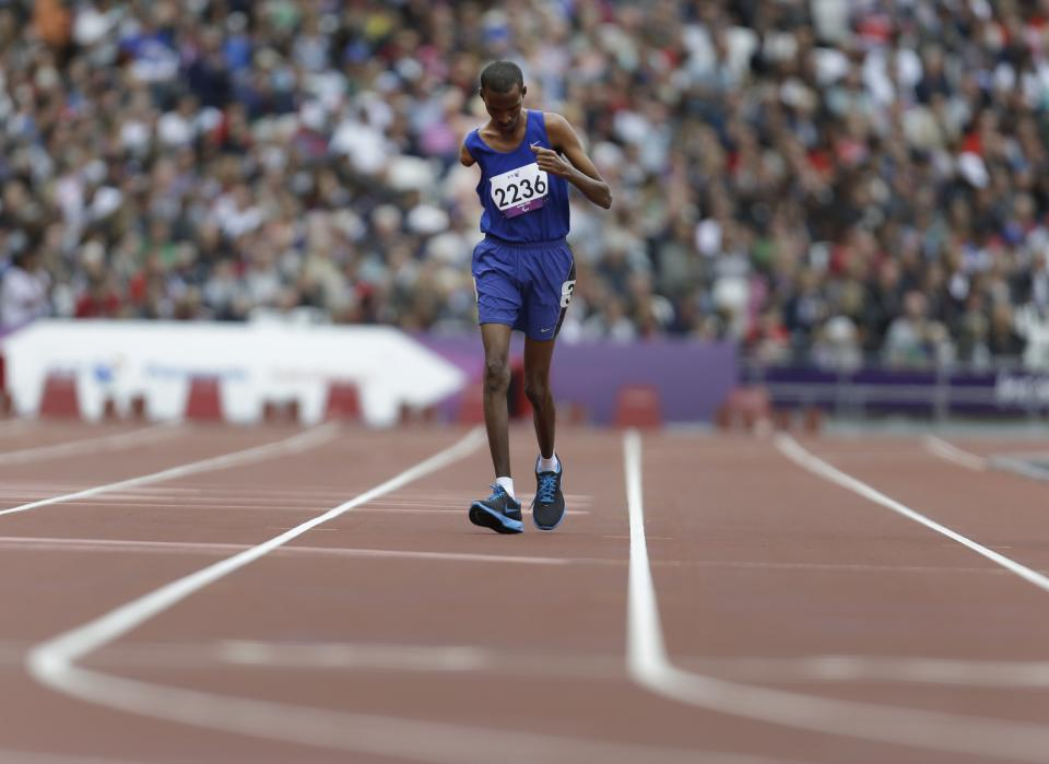 Djibouti's Houssein Omar Hassan races during a men's 1500m T46 round 1 race at the 2012 Paralympics in London, Saturday, Sept. 1, 2012. (AP Photo/Lefteris Pitarakis)