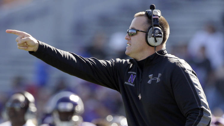 Northwestern coach Pat Fitzgerald points as he yells to his team during the first half of an NCAA college football game against South Dakota in Evanston, Ill., Saturday, Sept. 22, 2012. (AP Photo/Nam Y. Huh)
