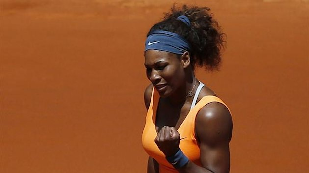 Serena Williams of the U.S. celebrates winning a point during her women's singles match against Maria Kirilenko of Russia at the Madrid Open tennis tournament, May 9, 2013. (Reuters)