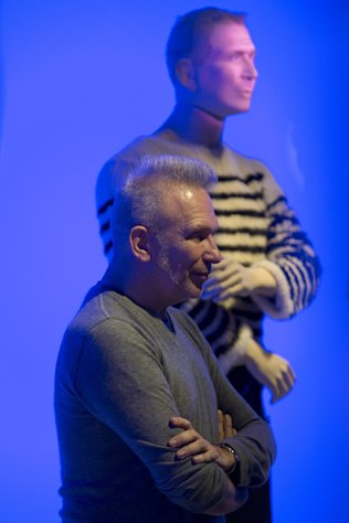 French fashion designer Jean Paul Gaultier poses next to his effigy during the opening of the exhibit &quot;The Fashion World of Jean Paul Gaultier, from the sidewalk to the catwalk&quot;, at Kunsthal museum in Rotterdam, Netherlands, Friday Feb. 8, 2013. The exhibit open Feb. 10, 2013. (AP Photo/Peter Dejong)
