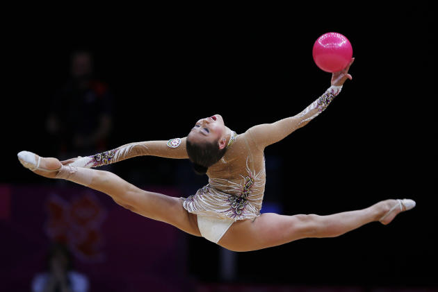 Azerbaijan's Aliya Garayeva competes using the ball in the individual all-around rhythmic gymnastics final at the London 2012 Olympic Games