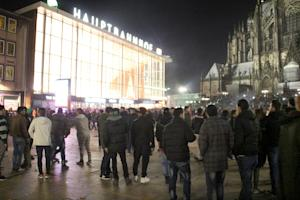 People gather in front of the main railway station …