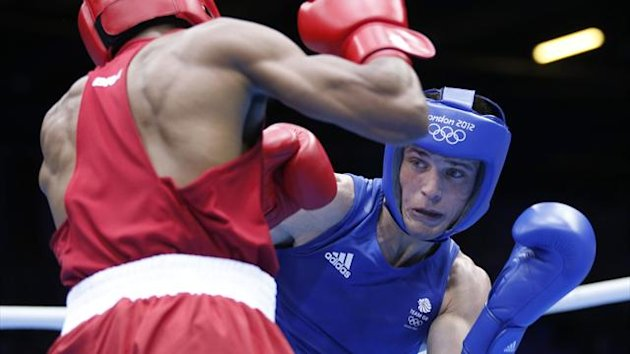 Brazil's Conceicao fights against Britain's Taylor in the men's light (60kg) Round of 32 (Reuters)
