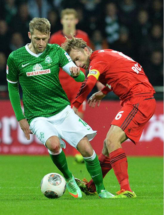 Bremen's Aaron Hunt, left,  vies  for the ball with Leverkusen's Simon Rolfes during the German Bundesliga match between Werder Bremen and Bayer Leverkusen at Weserstadion in Bremen,Germany, S