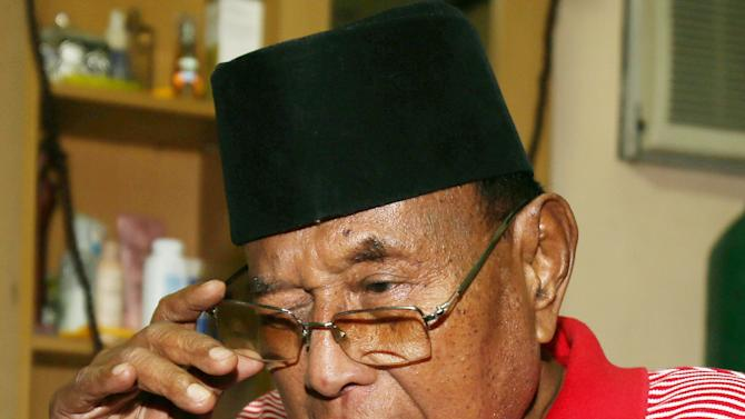 Filipino Sultan Jamalul Kiram III arranges his glasses inside his residence in Taguig, south of Manila, Philippines on Thursday, March 7, 2013. Malaysian police said their security forces gunned down 31 Filipino followers of Kiram in Borneo on Thursday, the highest number of casualties in a single day since nearly 200 members of a Philippine Muslim clan took over an entire village last month. Kiram had ordered his followers to observe a unilateral cease-fire starting Thursday afternoon by holding their current position and taking a defensive posture. (AP Photo/Aaron Favila)