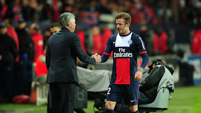 David Beckham shakes hands with PSG manager Carlo Ancelotti after being substituted out in the 83rd minute Saturday. (Getty)
