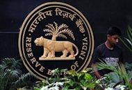 A gardener tends to plants at the entrance to The Reserve Bank of India (RBI) headquarters in Mumbai in April 2012. India's central bank likely intervened in foreign exchange markets on Tuesday after the rupee breached the key 54 level against the dollar, nearly hitting its lifetime low, dealers said