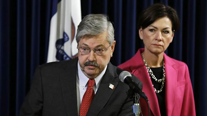 This photo taken Monday, Oct. 21, 2013 shows Iowa Gov. Terry Branstad, left, accompanied by Lt. Gov. Kim Reynolds, speaking during his weekly news conference at the Statehouse in Des Moines, Iowa. Fed up and ready to get off the sidelines, veteran Iowa Republicans are working to wrest control of the state GOP from the evangelicals, tea partyers and libertarians they blame for alienating longtime party loyalists. Led by Branstad, these Republicans want to grow the state party _ one that ideological crusaders have shaped over the past few years _ by bringing back into the fold pragmatic-minded voters while attracting more women and younger voters. (AP Photo/Charlie Neibergall)
