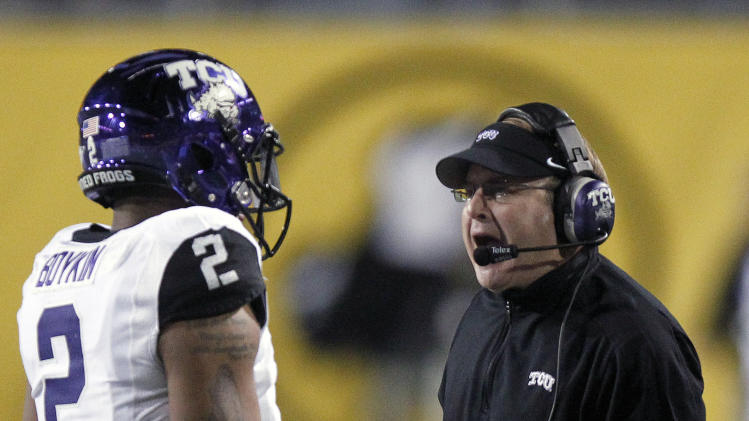 TCU coach Gary Patterson, right, shouts at quarterback Trevone Boykin, left, as Boykin walks off the field against Michigan State during the first half of the Buffalo Wild Wings Bowl NCAA college football game Saturday, Dec. 29, 2012, in Tempe, Ariz. (AP Photo/Paul Connors)