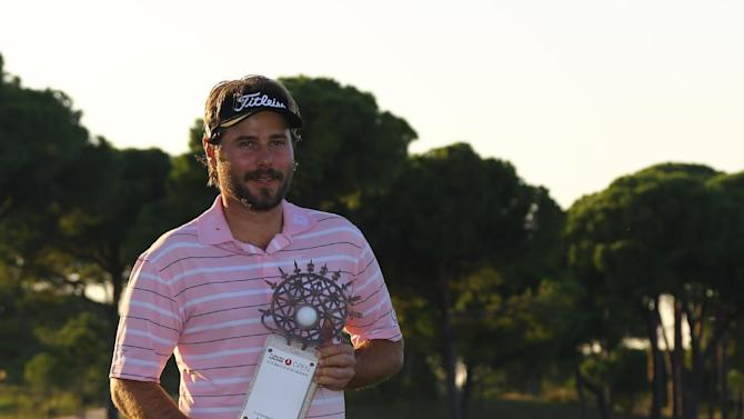 Victor Dubuisson of France holds his trophy after winning the Turkish Open golf tournament at the Montgomerie Maxx Royal Course in Antalya, Turkey, Sunday, Nov. 10, 2013. (AP Photo/Kaan Soyturk)