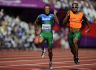 Brazil&#39;s Daniel Silva (left) and guide Heitor de Oliveira Sales compete in the men&#39;s 200m T11 semi-final at the London Paralympics Games on September 4. Spurred on by Icelandic songstress Bjork, crowds at the London 2012 Paralympics are keeping a lid on their excitement for blind sports that need to be played in silence