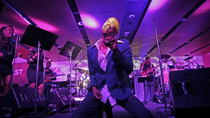 "Tevin Campbell performs at the Essence Festival in New Orleans, Saturday, July 5, 2014. R&B singer Campbell, who thrilled fans as a teenager when he asked ""Can We Talk,"" is performing for the first time at the Essence Festival as he seeks to re-ignite his career. (AP Photo/Gerald Herbert)"