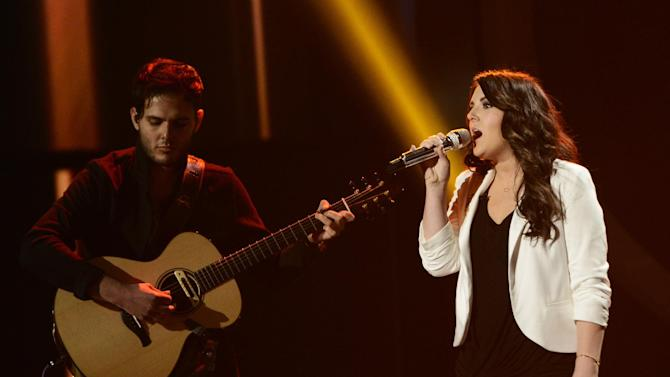 """This publicity photo released by Fox shows Kree Harrison, right, performing on """"American Idol,""""  Wednesday, May 8 (8:00-10:00 PM ET/PT) on Fox. The current 12th season is set to conclude Thursday, May 16, 2013, with a showdown between the 23-year-old R&B vocalist Candice Glover of St. Helena Island, S.C., and the 22-year-old country crooner Harrison of Woodville, Texas. (AP Photo/Fox, Michael Becker)"""