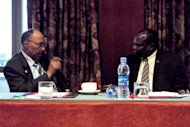 Sudans defence minister, Abdelrahim Mohamed Hussein (left) speaks with South Sudan&#39;s chief negotiator Pagan Amum during African Union-led peace talks in Addis Ababa on July 5. South Sudan set out Monday a proposed deal with rival Sudan, offering an increased oil transit fee offer, an $8.2 billion financial support package and demanding a referendum on disputed Abyei