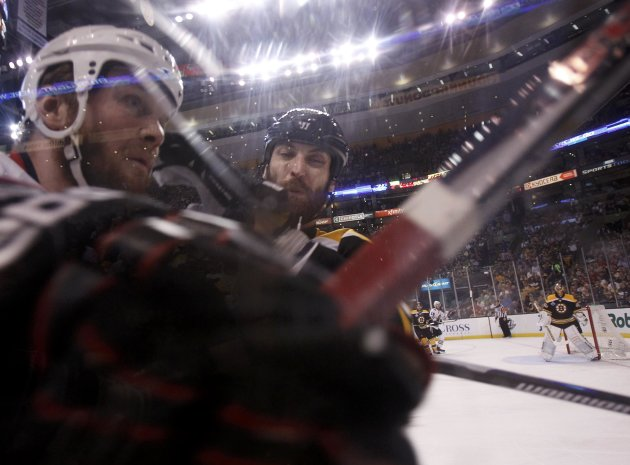Bruins' Chara takes Blackhawks' Bickell into the glass during the first period in Game 4 of their NHL Stanley Cup Finals hockey series in Boston