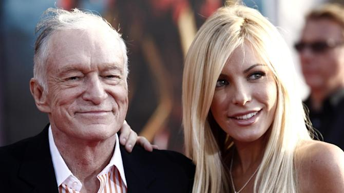 """FILE - In this April 26, 2010 file photo, Hugh Hefner, left, and Crystal Harris arrives at the premiere of """"Iron Man 2"""" at the El Capitan Theatre in Los Angeles. The 86-year-old Playboy magazine founder exchanged vows with his """"runaway bride,"""" Crystal Harris, at a private Playboy Mansion ceremony on New Year's Eve. Harris, a 26-year-old """"Playmate of the Month"""" in 2009, broke off a previous engagement to Hefner just before they were to be married in 2011. (AP Photo/Matt Sayles, File)"""