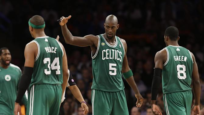 Boston Celtics center Kevin Garnett (5) congratulates forward Paul Pierce (34) as forward Jeff Green (8) returns to the bench during a timeout in the second half of Game 5 of their first-round NBA basketball playoff series against the New York Knicks at Madison Square Garden in New York, Wednesday, May 1, 2013. The Celtics won 92-86. (AP Photo/Kathy Willens)