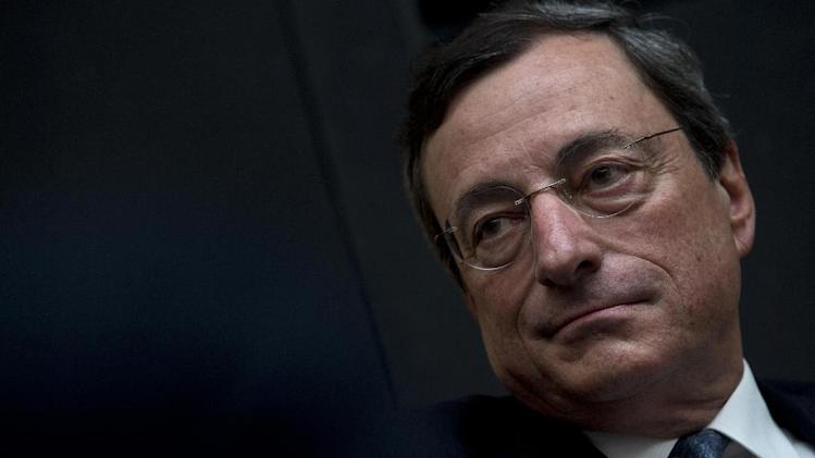 "European Central Bank President Mario Draghi listens to questions during a session of ""Room for Discussion"" at the Faculty of Economics of the UvA, or University of Amsterdam, Netherlands, Monday April 15, 2013. (AP Photo/Peter Dejong)"