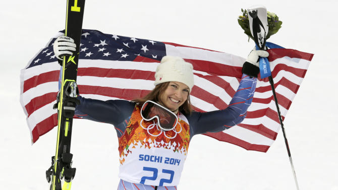 Women's supercombined bronze medalist United States' Julia Mancuso poses with the U.S. flag after a flower ceremony at the Alpine ski venue in the Sochi 2014 Winter Olympics, Monday, Feb. 10, 2014, in Krasnaya Polyana, Russia.(AP Photo/Charles Krupa)