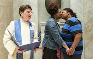 Rev. Jennie Barrington performs the marriage ceremony of Amanda Boyd and Narkisha Scott at the Pulaski County Courthouse in Little Rock