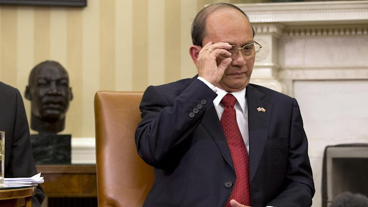 Myanmar's President Thein Sein adjusts his glasses while meeting with President Barack Obama in the Oval Office of the White House in Washington, Monday, May 20, 2013. Thein Sein is the first Myanmar president to be welcomed to the White House in almost 47 years. (AP Photo/Jacquelyn Martin)