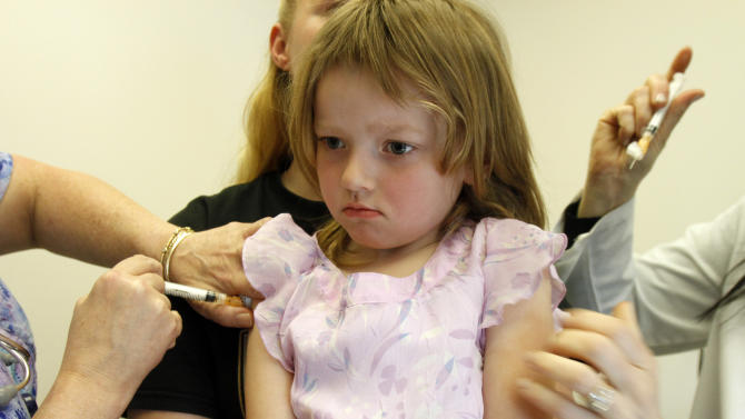 In this April 20, 2012, photo, Holly Ann Haley, 4, gets vaccinations at the doctor's office in Berlin, Vt. Vermont continues to be embroiled in a debate over ending the philosophical exemption that allows parents to have their kids skip the immunizations required for most children to attend school. (AP Photo/Toby Talbot)