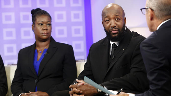 """In this image released by NBC, parents of Trayvon Martin, Sybrina Fulton, left, and Tracy Martin appear on the """"Today"""" show with co-host Matt Lauer in New York. Martin's parents plan to participate in separate vigils on Saturday. Sabrina Fulton and her other son Jahvaris Fulton will join Al Sharpton outside New York Police Department headquarters while Tracy Martin is set to be at a similar event at a federal courthouse in Miami. (AP Photo/NBC, Peter Kramer)"""