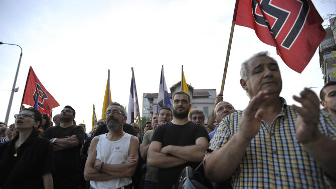 FILE - In this June 10, 2012, file photo, supporters  of the extreme right-wing Golden Dawn party, attend a pre-election rally at the northern port city of Thessaloniki Greece. Bankers, governments and investors are starting to prepare for Greece to drop the euro currency, a move that could spread turmoil throughout the global financial system. A Greek election on Sunday, June 12, 2012, will go a long way toward determining whether it happens. (AP Photo/Nicolas Giakoumidis, File)