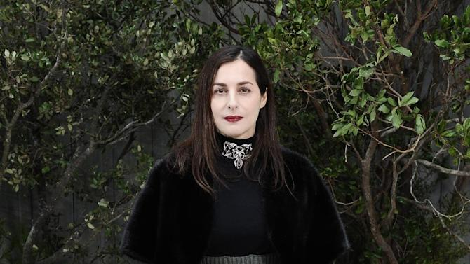 Amira Casar, French actress, attends the Chanel Spring/Summer 2013 Haute Couture fashion collection, in Paris, Tuesday, Jan. 22, 2013. (AP Photo/Zacharie Scheurer)