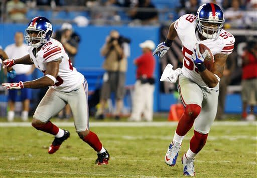 Brown runs for 2 TDs as Giants rout Panthers 36-7