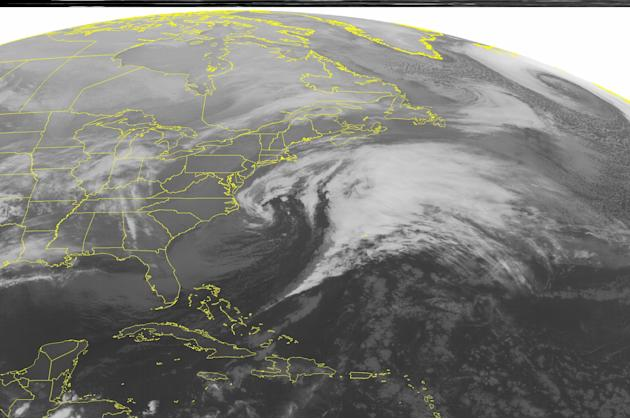 This NOAA satellite image taken Saturday, March 8, 2014 at 1:45 a.m. EST shows widespread cloud cover off the Eastern Seaboard associated with a storm centered off the Outer Banks of North Carolina. L