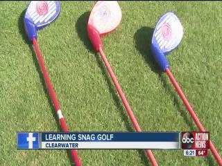 Instructors teaching a new form of Golf