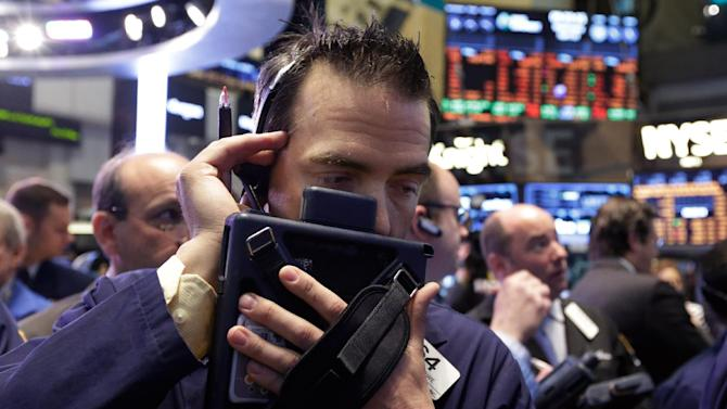 Trader Gregory Rowe, center, works on the floor of the New York Stock Exchange Wednesday, April 10, 2013. Stocks are opening higher on Wall Street, a day after the Dow Jones industrial average closed at its second all-time high in a week. (AP Photo/Richard Drew)