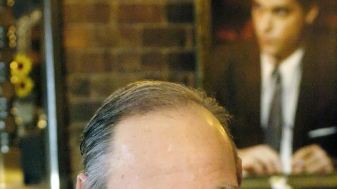 """FILE - In this  Feb. 22, 2005 file photo, Henry Hill sits in the Firefly restaurant in North Platte, Neb. Hill, whose life as a mobster and FBI informant was the basis for the Martin Scorcese film """"Goodfellas,"""" has died. Hill's girlfriend Lisa Caserta says he died in a Los Angeles hospital after a long illness. He was 69. (AP Photo/Nati Harnik)"""