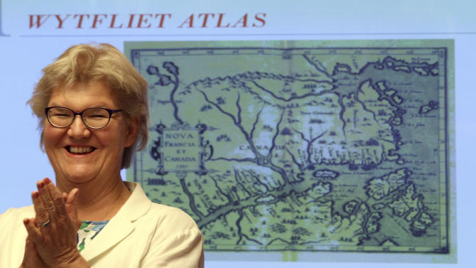 Gunilla Herdenberg, National Librarian at the Royal Library of Sweden, speaks to reporters during a news conference, Wednesday, June 27, 2012 in New York. The Wytfliet Atlas stolen a decade ago from the Royal Library of Sweden has been recovered in New York. (AP Photo/Mary Altaffer)
