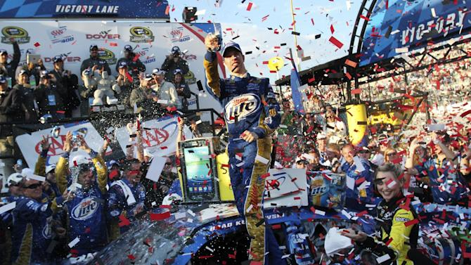 Brad Keselowski celebrates his win in victory lane at the NASCAR Sprint Cup Series auto race at Dover International Speedway, Sunday, Sept. 30, 2012, in Dover, Del. (AP Photo/The Wilmington News-Journal, Daniel Sato)  NO SALES