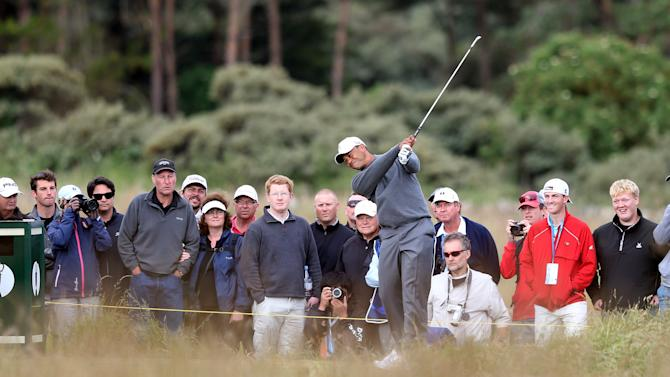 Tiger Woods plays a shot during a practice round ahead of the British Open Golf Championship, Muirfield, Scotland, Monday, July 15, 2013. The British Open begins on Thursday, July 18. (AP Photo/Scott Heppell)