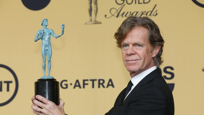"""Actor William H. Macy holds his award for Outstanding Performance by a Male Actor in a Comedy Series for his role in the Showtime series """"Shameless"""" at the 21st annual Screen Actors Guild Awards in Los Angeles"""