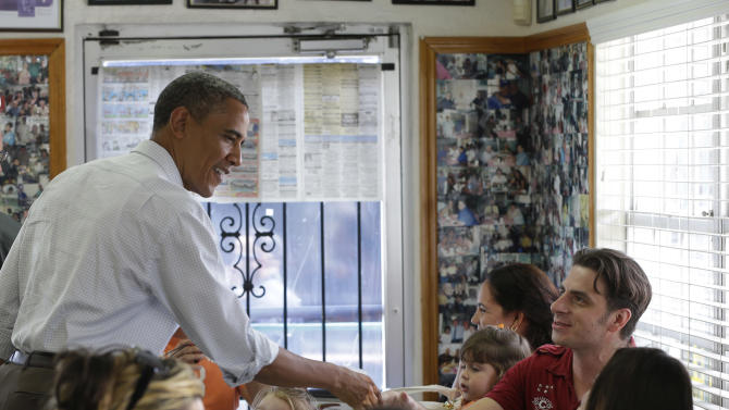 President Barack Obama greets patrons during an unannounced stop at the West Tampa Sandwich Shop and Restaurant, during an unannounced stop, Saturday, Sept. 8, 2012, in Tampa, Fla. (AP Photo/Pablo Martinez Monsivais)