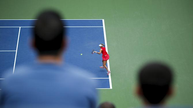 Makarova of Russia hits a return to Svitolina of Ukraine during their match at the U.S. Open Championships tennis tournament in New York