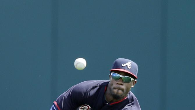 FILE - In this March 11, 2015, file photo, Atlanta Braves center fielder Eric Young Jr. makes a diving catch for the out on fly ball hit by St. Louis Cardinals' Thomas Pham during the fifth inning of a spring training exhibition baseball game in Lake Buena Vista, Fla. One major benefit for the 29-year-old Young is his speed. (AP Photo/Carlos Osorio, File)