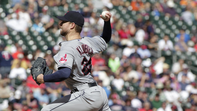 Cleveland Indians starting pitcher Corey Kluber delivers during the third inning of a baseball game against the Minnesota Twins, Sunday, Sept. 21, 2014, in Minneapolis. Cleveland won 7-2. (AP Photo/Paul Battaglia)
