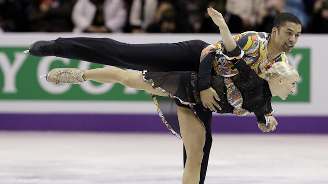 Aliona Savchenko and Robin Szolkowy, of Germany, perform during the pairs free program at the World Figure Skating Championships Friday, March 15, 2013, in London, Ontario. (AP Photo/Darron Cummings)