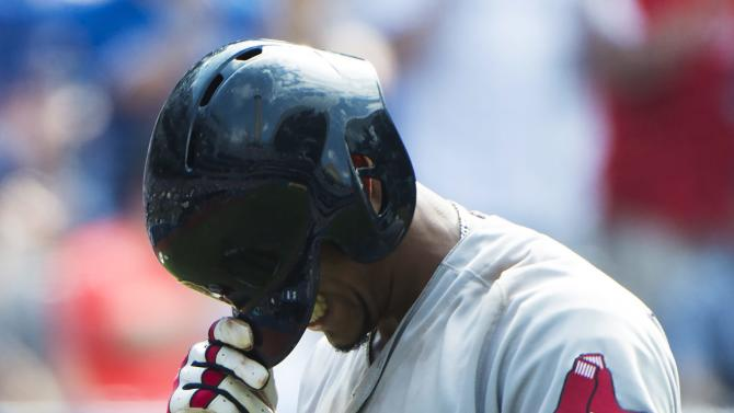 Boston Red Sox's Xander Bogaerts  reacts after striking out against the Toronto Blue Jays during the ninth inning of a baseball game in Toronto, Saturday, May 28, 2016. (Nathan Denette/The Canadian Press via AP) MANDATORY CREDIT
