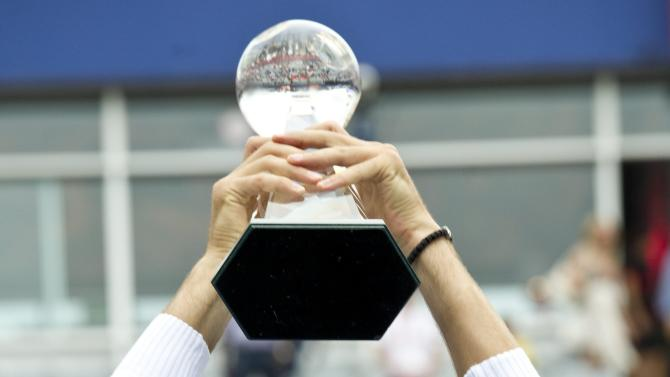 Novak Djokovic, from Serbia, raises the trophy after defeating Mardy Fish, from the United States, to win the men's final at the Rogers Cup tennis tournament  on Sunday, Aug. 14, 2011, in Montreal. (AP Photo/The Canadian Press, Paul Chiasson)