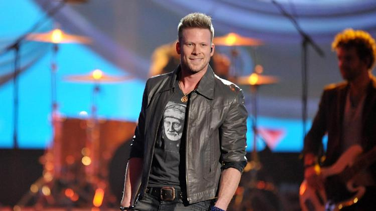 FILE - This Nov. 24, 2013 file photo shows Brian Kelley of the musical group Florida Georgia Line on stage at the American Music Awards in Los Angeles. Kelley of the country duo Florida Georgia Line capped off a year full of awards and breaking records by marrying his girlfriend Brittney Marie Cole at an intimate ceremony in Nashville. The wedding on Monday, Dec. 16, was first reported by People magazine. The band's publicist said the ceremony included just 40 guests at sunset, followed by a reception at Kelley's 32-acre property. (Photo by John Shearer/Invision/AP, File)