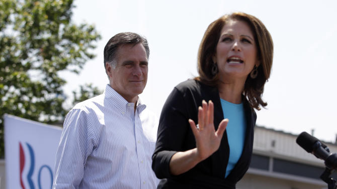 Republican presidential candidate, former Massachusetts Gov. Mitt Romney, left, is introduced by Rep. Michele Bachmann, R-Minn., at a campaign stop in Portsmouth, Va., Thursday, May 3, 2012. (AP Photo/Jae C. Hong)
